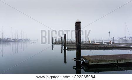 Empty docks on a misty morning - landscape view