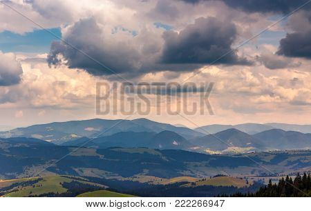 sky with heavy clouds over the mountain ridge. beautiful summertime landscape