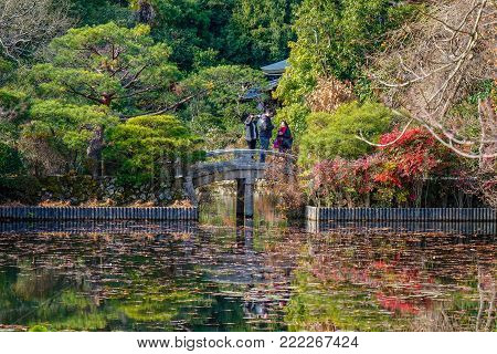 Kyoto, Japan - Dec 26, 2015. People visit a autumn park in Kyoto, Japan. Kyoto was the capital of Japan for over a millennium, and carries a reputation as its most beautiful city.