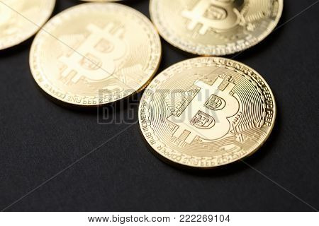 Bitcoin gold coin and dark background. Virtual cryptocurrency concept.
