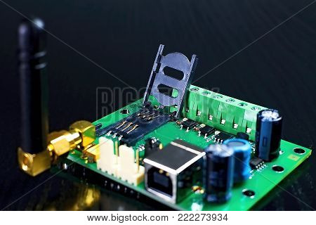 Connector for inserting a SIM card. Opened SIM card holder as part of GSM communicator with antenna.