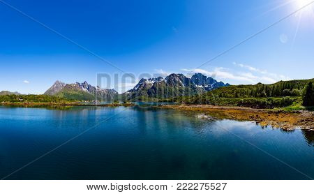 Lofoten is an archipelago in the county of Nordland, Norway. Is known for a distinctive scenery with dramatic mountains and peaks, open sea and sheltered bays, beaches and untouched lands.