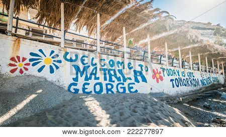 Matala, Crete, Greece: June 30, 2016: Hippies logo on the Matala beach in Crete island. Today is life tomorrow never come.