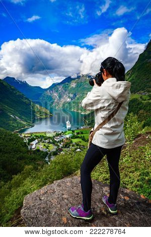 Geiranger fjord, Beautiful Nature Norway panorama. Nature photographer tourist with camera shoots.