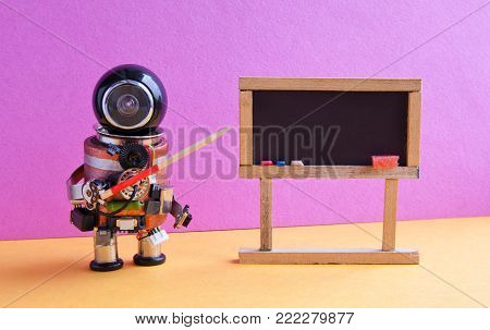 Robot explains modern theory. Teacher with a pointer near chalkboard, artificial intelligence machine learning concept. Pink wall yellow flor interior classroom