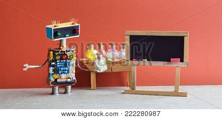 Pharamacy chemistry laboratory research center. Robot with chemical glass. Black empty chalkboard, wooden table and reagent glass bottles, drugs pills. Bright red wall gray floor interior.