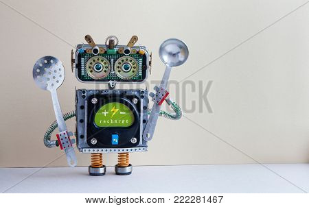 Robot chef with ladle skimmer, recharge battery message green interface body. Creative design cyborg toy, kitchen utensils on beige gray background. Copy space.