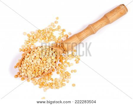 A wooden spoon pile of peas a wooden spoon on a white background, top view