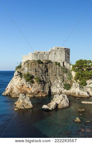 View of Fort Lovrijenac (St. Lawrence Fortress) on a steep cliff in Dubrovnik, Croatia, on a sunny day. Copy space.