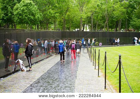 WASHINGTON DC - May 10, 2016: Vietnam Veterans Memorial, in Washington DC, Vietnam Memorial Wall, designed by Maya Lin, dedicated in 1982