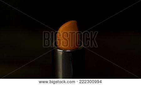 Red Lipstick Isolated On Black Background. Red Melting Lipstick Isolated On Black Background With Dr