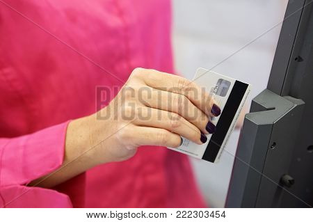Credit card payment terminal in store. Seller draws up credit card purchases. close-up of a seller with a credit card