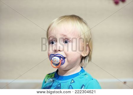 unhappy baby is sitting and crying out loud