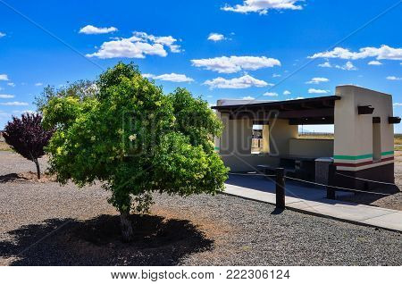 a covered picnic table at a rest area