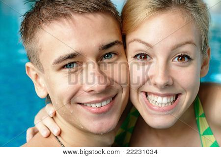 Smiling young couple at the pool
