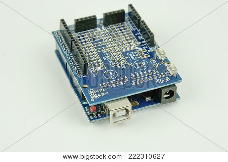 Close up of Arduino board on white background, selective focus.
