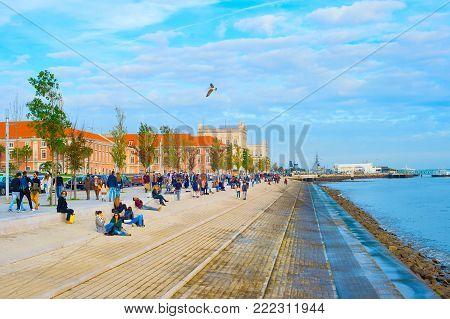 People At  Embankment. Lisbon, Portugal