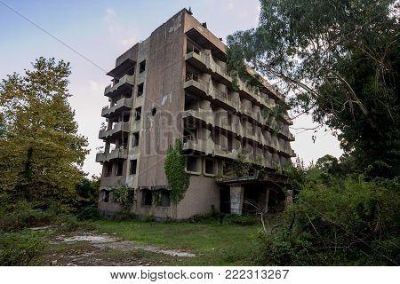 Abandoned multi-story building. Abandoned sanatorium in Eshera, Abkhazia, Georgia.