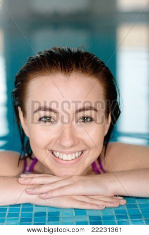 Beautiful girl at the swimming pool