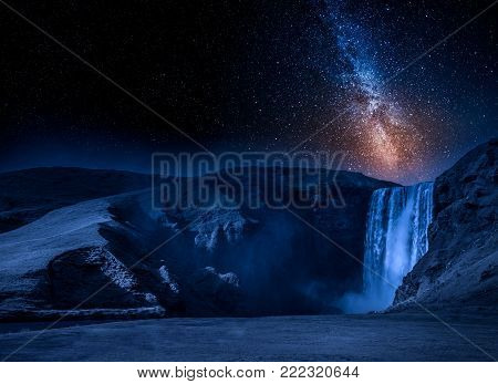 Milky way and spectacular Skogafoss waterfall in Iceland
