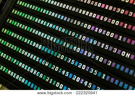 Colorful electronic airport departures or arivals board.
