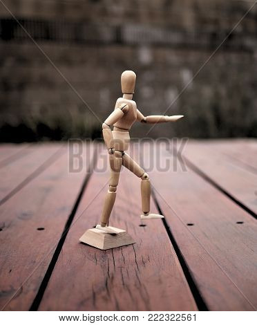 Wooden Articulating Drawing Mannequin Running on Deck