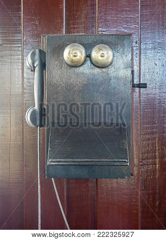 Antique Old Telephone Hang On Wooden Wall