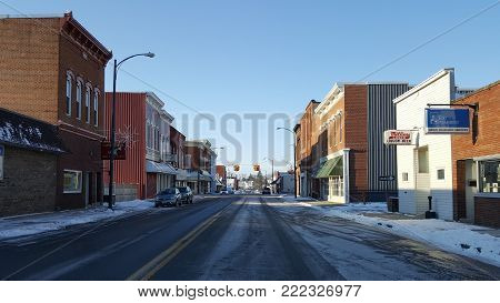 Old Fashioned Small Town Main Street with store fronts along the side of the road in winter under a clear blue sky, Columbus Grove, Ohio, December 26, 2017