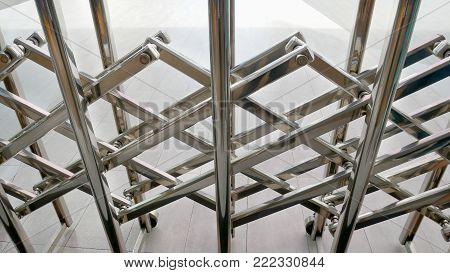 Shiny Stainless Steel Expandable Fence Blocking the Way