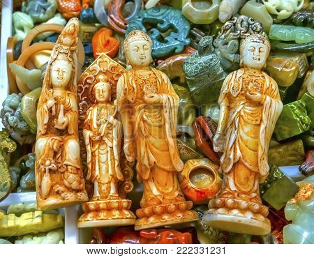 Chinese Replica Plastic Buddhas Decorations Panjuan Flea Market  Decorations Beijing China.  Panjuan Flea Curio market has many fakes, replicas and copies of older Chinese products, many ancient.