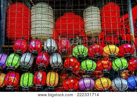 Colorful Blue Red Green Chinese Paper Lanterns Panjuan Flea Market  Beijing China. Panjuan Flea Curio market has many fakes, replicas and copies of older Chinese products, many ancient. One Chinese character says luck.