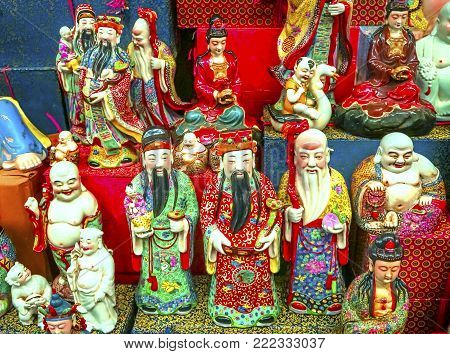 Chinese Replica Ceramic Taoist Gods Buddhas Decorations Panjuan Flea Market  Decorations Beijing China.  Panjuan Flea Curio market has many fakes, replicas and copies of older Chinese products, many ancient.