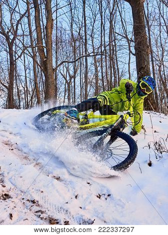 Moscow, Russia - January 2018: Winter cycling. Extreme riding on a mtb, mountain bicycle in the snow in the winter forest. Athlete on bicycle at winter. MTB biking.