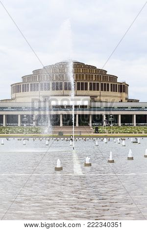 WROCLAW - POLAND, JUNE 13, 2017 : Centennial Hall and Multimedia Fountain. It is sport and entertainment hall built in years 1911-1913, listed as a UNESCO World Heritage Site in 2006