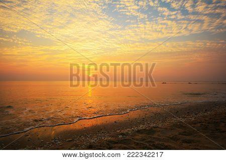 Beautiful sunset on the beach (Had-Sai-Med-Rak) at Phetchaburi province, Thailand.
