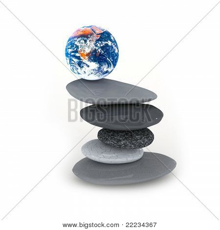 Stacked pebbles and globe