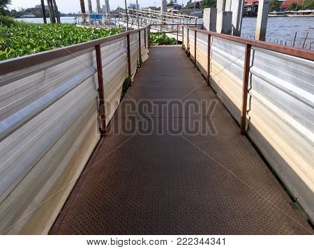 Riverside View of Diamond Checkered Plate Walkway to the Pier