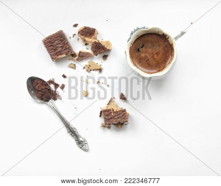 A cup of coffee and waffles on white background, cracked waffles, coffee and dessert