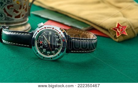 Moscow, Russia - Yanuary 14, 2018: Old soviet military wristwatches with acessories on the table coverd with a green felt