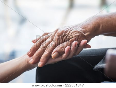Parkinson disease patient, elderly senior person in support of nursing family caregiver for disability awareness day concept