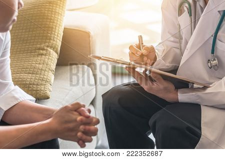 Woman Patient Having Consultation With Doctor (gynecologist Or Psychiatrist) And Examining  Health I