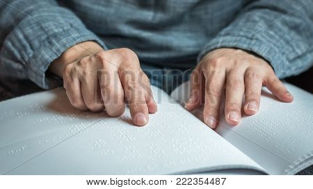 BANGKOK, THAILAND- January 23, 2018: Braille book for low vision/ blind person reading Braille sign finger touching texture paper