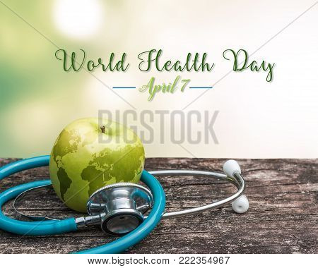 World health day symbolic concept with map on healthy nutritional apple with doctor's stethoscope