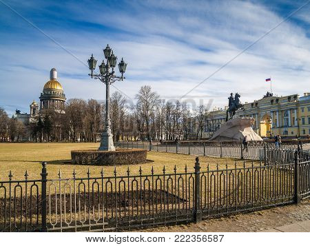 View of the Senate Square with a monument to Peter I and St. Isaac's Cathedral in the center of St. Petersburg on a warm day  early spring in the month of April, Russia