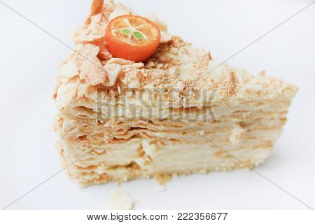 Mille Feuille Cake, Vanilla Custard Slice Pastry on White Plate. Also Known as Napoleon Cake, is a French Sweet Dessert Pie with Many Layers of Cream and Puff Dough, Freshly Baked Bakery Product.