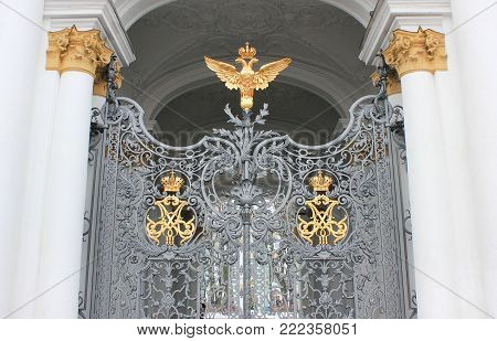 ST. PETERSBURG, RUSSIA - JANUARY 9, 2018: Two-Headed Eagle, Russian Coat of Arms Symbol on Winter Palace Gates. Golden Russian Empire Double-Headed Eagle Architecture Detail, Old Imperial Ornament.