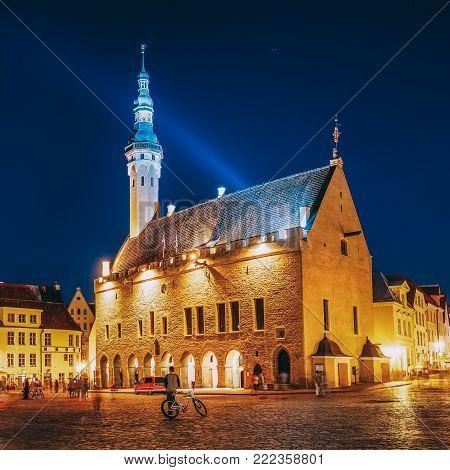 Tallinn, Estonia. Town Hall Square - Raekoja Plats. Famous Landmark In Evening Night Illumination Under Blue Sky.
