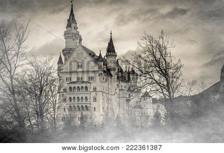 Mysterious gothic Neuschwanstein castle in the fog, Bavarian Alps, Germany