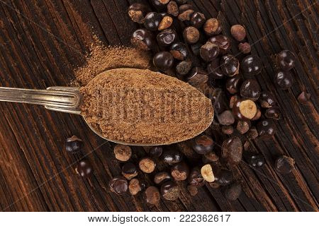 Portion Of Guarana Powder From Above On Wooden Table With Guarana Seeds. Dietary Supplement. Flat La
