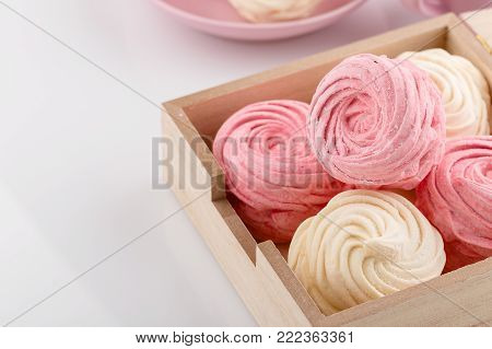 Set of homemade white and pink zephyr or marshmallow in wooden box. Marshmallow, Meringue, Zephyr